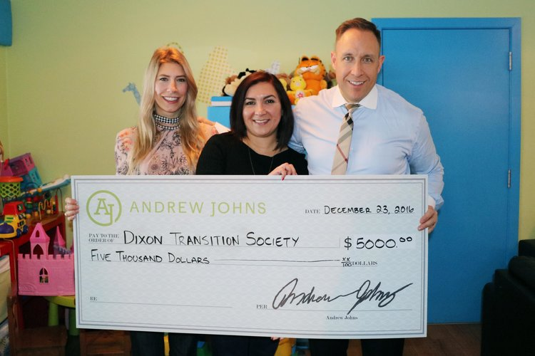 Crystal Johns, Pany Aghili, and Andrew Johns (the host of Coastal Front podcast) holding a $5,000 cheque for Dixon Transition Society